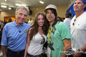 John Walsh, his daughter, Anthony Kiedis and Chad Smith pose for a photo during the NASCAR Nextel Cup Series All-Star Challenge