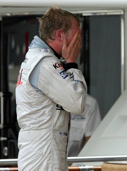 Kimi Raikkonen reacts after retiring