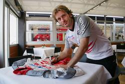 Jarno Trulli signs his overalls