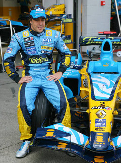 Fernando Alonso poses with new livery designed by Taiwanese design studio DEM