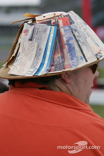 A fan with a hat of old race tickets