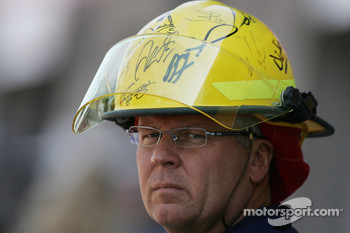 A fire marshall with his helmet signed