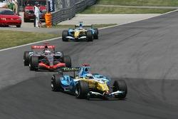 Fernando Alonso, Kimi Raikkonen and Giancarlo Fisichella