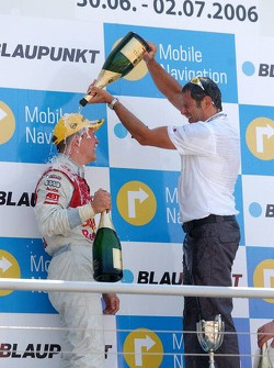 Podium: Hans-Jurgen Abt gives Mattias Ekström a champagne shower