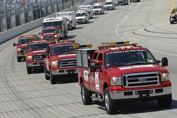 A fleet of Ford rescue vehicles parade around the Chicagoland Speedway