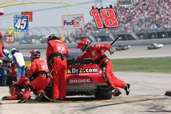 A crew member for Jeremy Mayfield doesn't touch the ground during the pitstop