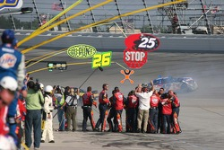 Jeff Gordon's crew celebrate as Matt Kenseth slides to a stop