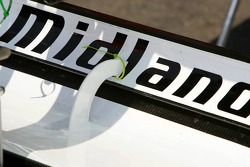 The bracket connecting the two rear wing plates on the Midland car