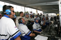 Dyson Racing crew members celebrate as Butch Leitzinger takes the pole position