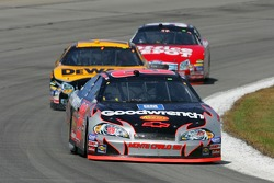 Kevin Harvick leads Matt Kenseth and Carl Edwards