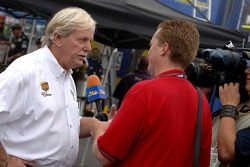 Robert Yates chats with a TV crew