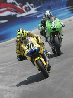 Valentino Rossi being chased by Shinya Nakano