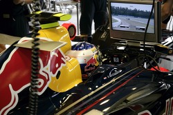 Robert Doornbos looks on a monitor in the garage