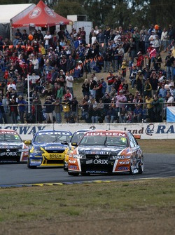 Garth Tander leads the field through turn 1