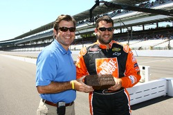 IMS President and COO Joie Chitwood presented 2005 Allstate 400 at the Brickyard winner Tony Stewart with a brick from the original track