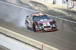 Elliott Sadler pulls down pit road after hitting the wall