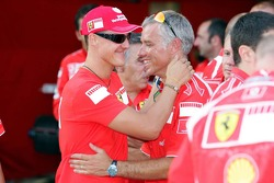Michael Schumacher and a Ferrari mechanic