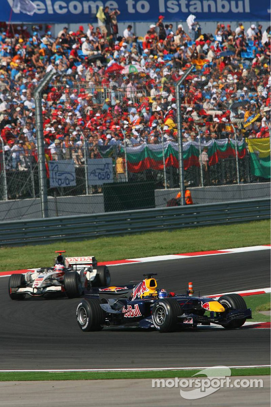 Christian Klien leads Jenson Button