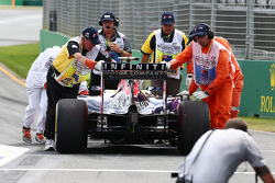 Daniel Ricciardo, Red Bull Racing RB11 is pushed to the pit lane by marshals