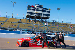 The car of Kurt Busch, Stewart-Haas Racing Chevrolet being pushed on pit road