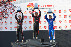 Podium: Second place Will Power, Team Penske Chevrolet, Race winner Juan Pablo Montoya, Team Penske Chevrolet and Third place Tony Kanaan, Chip Ganassi Racing Chevrolet