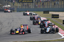 Daniil Kvyat, Red Bull Racing RB11 and Sergio Perez, Sahara Force India F1 VJM08 battle for position