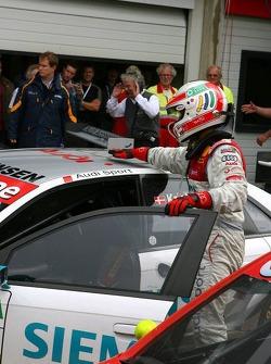 Tom Kristensen pets his car after winning the race
