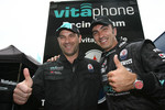 Pole winners Michael Bartels and Andrea Bertolini celebrate