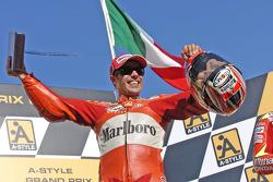 Podium: race winner Loris Capirossi celebrates