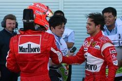Pole winner Felipe Massa celebrates with Michael Schumacher