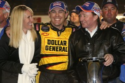 2006 NASCAR Busch Series Champion Kevin Harvick celebrates with wife Delana and Richard Childress
