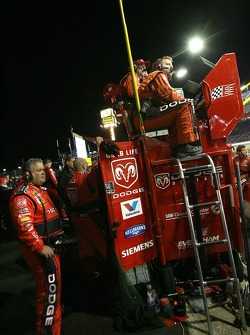 Dodge Dealers/UAW Dodge crew members watch the end of the race