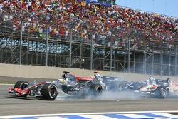 Pedro de la Rosa smokes his tires while Mark Webber and Nico Rosberg crash
