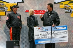 NASCAR President Mike Helton presents a check to Pattie and Kyle Petty for the Victory Junction Gang