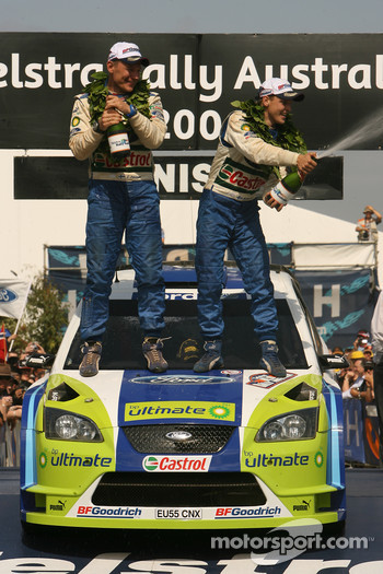 Podium: champagne for Mikko Hirvonen and Jarmo Lehtinen