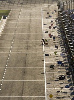 A lone tire engineer checks the track temperature