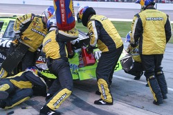 Crew member try to foce racing fuel in Robby Gordon's damaged car