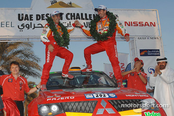 Car category podium: winners Luc Alphand and Gilles Picard celebrate