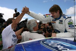 Marcus Gronholm celebrates with BP Ford World Rally team members their win and 2006 World Rally manufacturers championship
