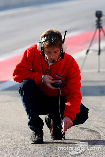 A Bridgestone engineer checks the track temperature