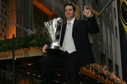 Jimmie Johnson poses outside the Waldorf=Astoria hotel in New York city with the NASCAR NEXTEL Cup