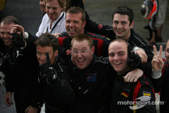 Jonny Reid's win is celebrated by his team mechanics