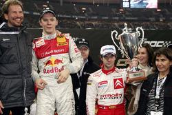 Race of Champions winner Mattias Ekström celebrates with Sébastien Loeb and Fredrik Johnsson