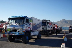 Trucks out of the ferryboat on their way to the start of stage 3