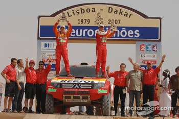 Car category podium: Stphane Peterhansel and Jean-Paul Cottret celebrate