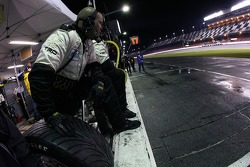 Exchange Traded Gold AIM Autosport crew member waits for a pitstop