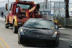A Lamborghini is prepared to be towed from a no parking zone