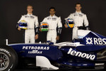 Nico Rosberg, Narain Karthikeyan and Alexander Wurz pose with the Williams FW29