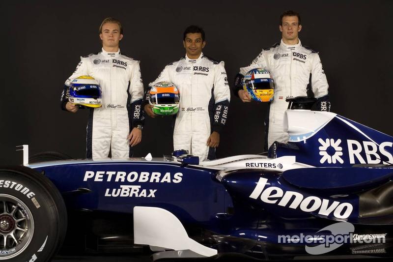 Nico Rosberg, Narain Karthikeyan and Alexander Wurz pose with the Williams FW29