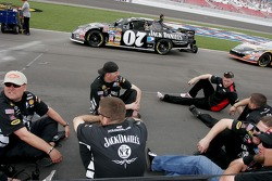 Clint Bowyer's crew takes a breather before the qualifying run